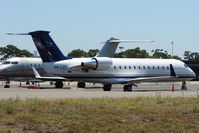 VH-LEF @ YSSY - Executive Challenger 850 at Sydney