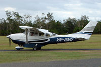 VH-DNU @ YCAB - Cessna 206 flying at Caboolture , QLD