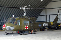 N37995 @ YCUD - Bell UH-1B hangared at Caloundra, Queensland , Australia - US Reg cax 6/2/2009 - not taken up its new marks yet