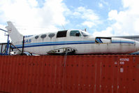 VH-ROX @ YCUD - Cessna 402A now sits WFU on top of a container at Caloundra