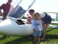C-GGTI - Owner/Pilot with grandson - by Carl Juergensen
