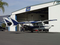 N11WS @ POC - Being worked on at NAI Aircraft Services at Brackett - by Helicopterfriend
