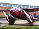 BAPC280 @ EGGP - Replica of a Dragon Rapide on display in front of the old Liverpool Airport, it used to wear the reg number G-ANZP - by Chris Hall