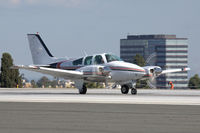 N3820M @ SMO - Baron Taking Off At SMO - by Curt Sletten