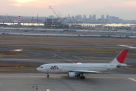 JA8376 @ RJTT - JAL A300 about to taxy as last light fades over Tokyo Haneda