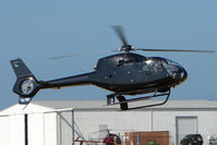 VH-YWY @ YMMB - EC120B lifts off at Moorabbin