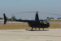 VH-JKF @ YMEN - Robinson R44 at Essendon