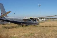 VH-UJG @ YMEN - Aero Commander 690 in storage area at Essendon