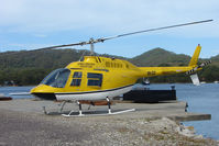 VH-CLY - Cradle Mountains Bell 206 rests on the Strahan Harbour Helipad