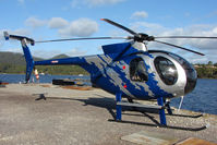 VH-MDL - Hughes 369D on the Strahan Helipad , West Tasmania