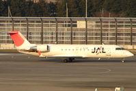JA205J @ RJAA - J-Air CLRJ at Narita