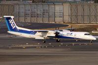 JA850A @ RJAA - ANA Dash 8 at Narita