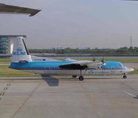 PH-KVK @ EGLC - Taken through glass from the departure lounge - by keith sowter