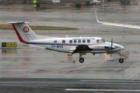 VH-MVS @ YSSY - Beech B200 landing in poor weather at Sydney