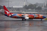 VH-VXB @ YSSY - Colourful Qantas livery brightens up a dismal Sydney day