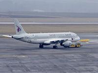 A7-ADB @ VIE - Preparing for a flight to Doha - by Patrick Radosta
