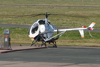 G-ZZTT @ EGBJ - Hughes 300C at the Gloucestershire Airport Fuel pump
