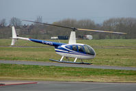 G-OMCD @ EGBJ - Robinson R44 II at Staverton