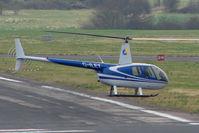 G-ILET @ EGBJ - Robinson R44 II at Staverton