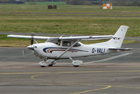 G-VALI @ EGBJ - Cessna 182 taxies in at Staverton
