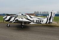 G-ZEBY @ EGNU - Piper PA-28-140 at  Full Sutton - in appropriate Zebra colour scheme