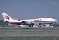 9M-MPE @ VIE - Malaysia Boeing 747-400 - by Yakfreak - VAP