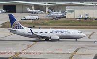 N12322 @ KFLL - Boeing 737-300 - by Mark Pasqualino