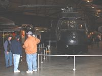 63-9676 @ FFO - A former crewman reminiscing and describing to friends the Sikorsky CH-3E Black Mariah at the USAF Museum in Dayton, Ohio. - by Bob Simmermon
