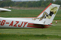 G-AZJY @ EGCB - Tail art on Cessna 150 at Manchester Barton