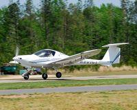 N901CT @ 5NC3 - Departing runway 31 - by John W. Thomas