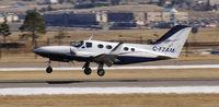 C-FZAM @ KAPA - Cessna landing 35R - by John Little