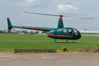 G-DIGG @ EGBK - Robinson R44II At Sywell in May 2009