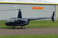 G-RYZZ @ EGBJ - Robinson R44 At Staverton in May 2009