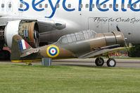G-AZBN @ EGBP - 1942 Noorduyn AT-16 Harvard IIB , FT391 , - dwarfed by Air Seychelles B767 - at Kemble on Great Vintage Flying Weekend