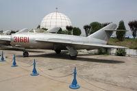 31681 - Shenyang J-5   Located at Datangshan, China - by Mark Pasqualino