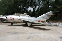 1991 - MiG-15 UTI - by Mark Pasqualino