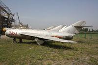 2424 - Shenyang J-5   Located at Datangshan, China - by Mark Pasqualino