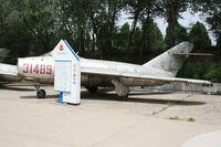 31489 - Shenyang J-5   Located at Datangshan, China - by Mark Pasqualino