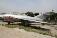 63635 - MiG-15 UTI - by Mark Pasqualino
