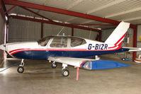 G-BIZR @ EGCL - Socata TB-9 hangared at 2009 May Fly-in at Fenland