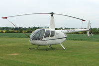 G-CESB @ EGSF - Robinson R44 At Conington in May 2009