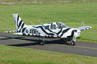 G-ZEBY @ EGBG - Striking colour scheme on this PIPER PA-28-140  at Leicester 2009 May Bank Holiday Fly-in
