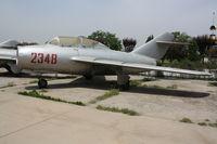2348 - MiG-15UTI  Located at Datangshan, China - by Mark Pasqualino
