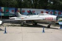 11323 - Shenyang J-6III  Located at Datangshan, China - by Mark Pasqualino