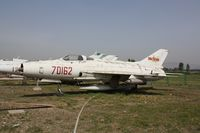 70162 - Chengdu J-7  Located at Datangshan, China - by Mark Pasqualino