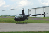 G-WIRL @ EGBJ - Robinson R22  at Gloucestershire Airport