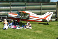 N5647S - The wings of the Maule provide shade for the picnic at the Abbots Bromley Fly-In