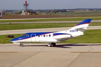 N106TW @ CID - Taxiing to Runway 27 for departure - by Glenn E. Chatfield