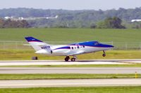 N106TW @ CID - Rotating on the take-off roll on Runway 27 - by Glenn E. Chatfield