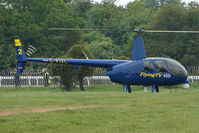 G-PIXL - Robinson R44 II used to cover the horse racing for live TV from Epsom - by Terry Fletcher